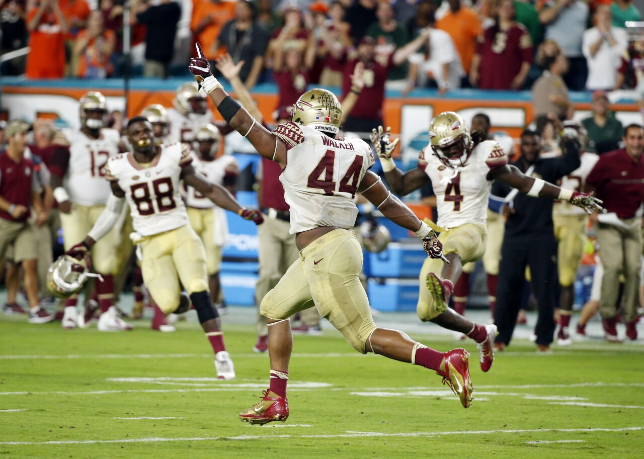 Florida State Seminoles defensive end DeMarcus Walker celebrates after blocking extra point against Miami Hurricanes in 2016