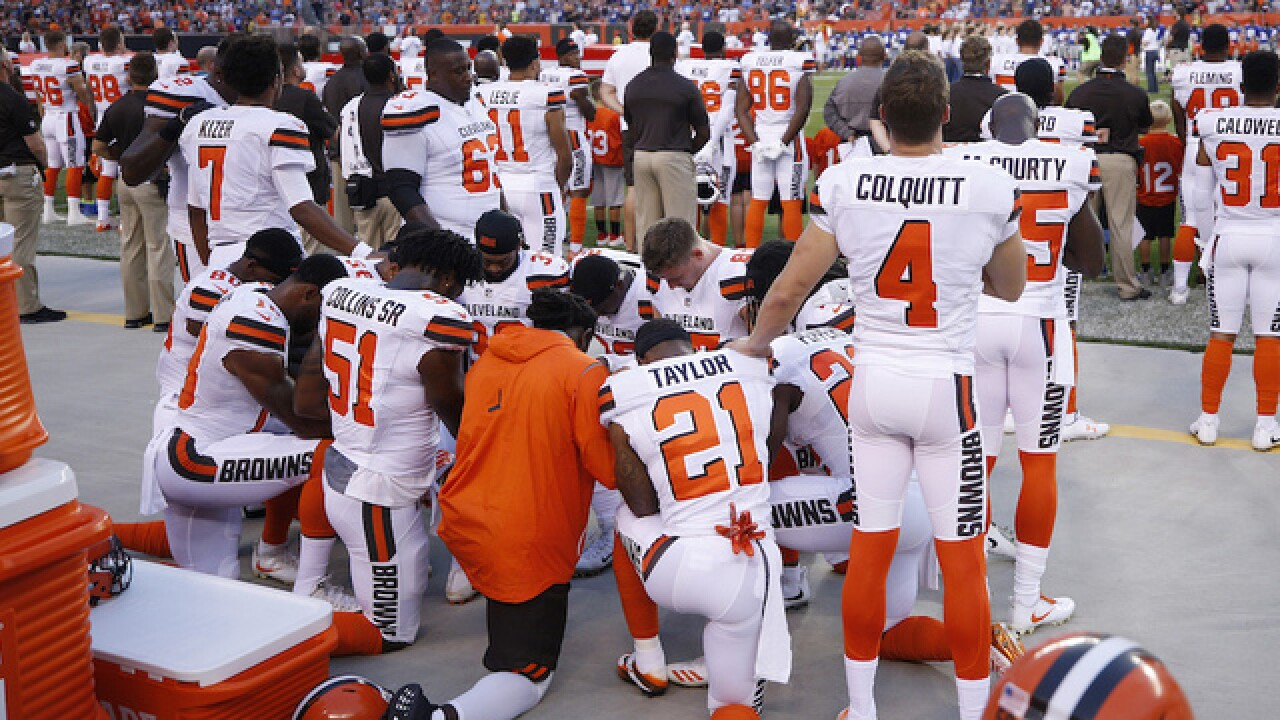 Diverse group of Cleveland Browns players take part in largest sports anthem protest