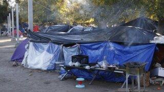 migrant tent camps.jpg