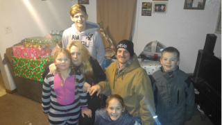 Charitable organizations deliver gifts to Muskegon Township family stricken by cancer