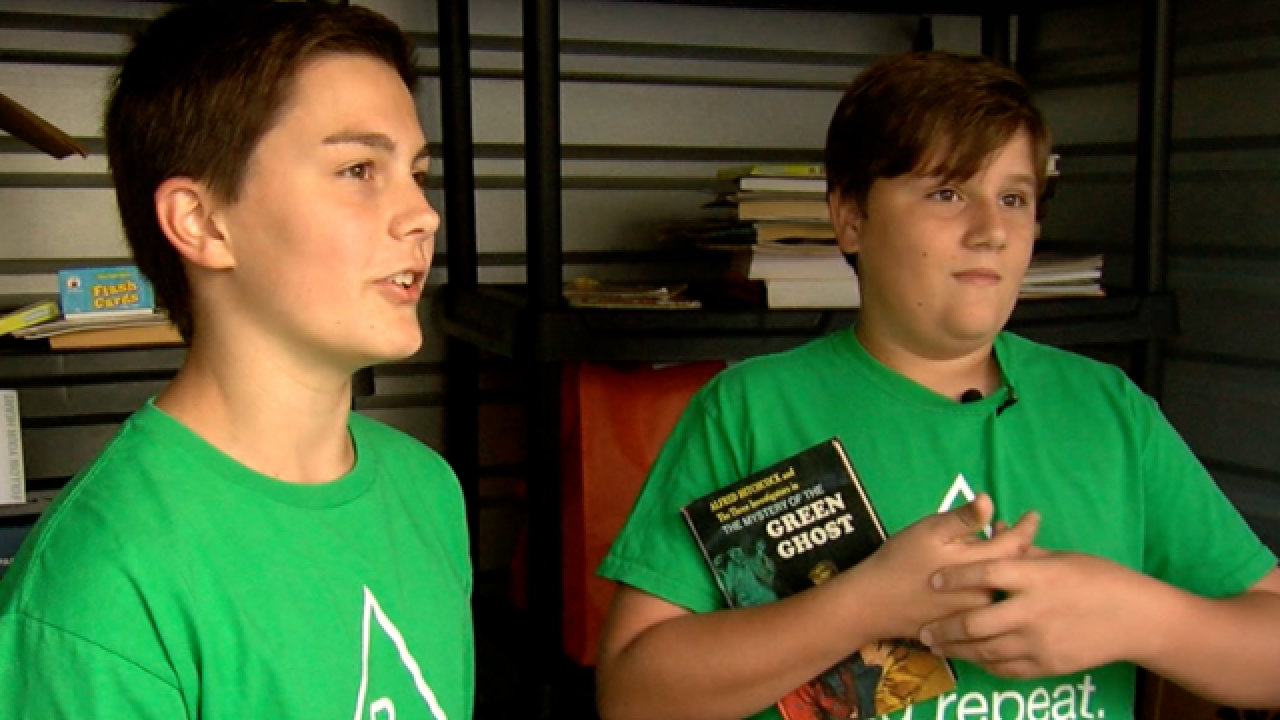 Boys help save 38,000 books from landfills