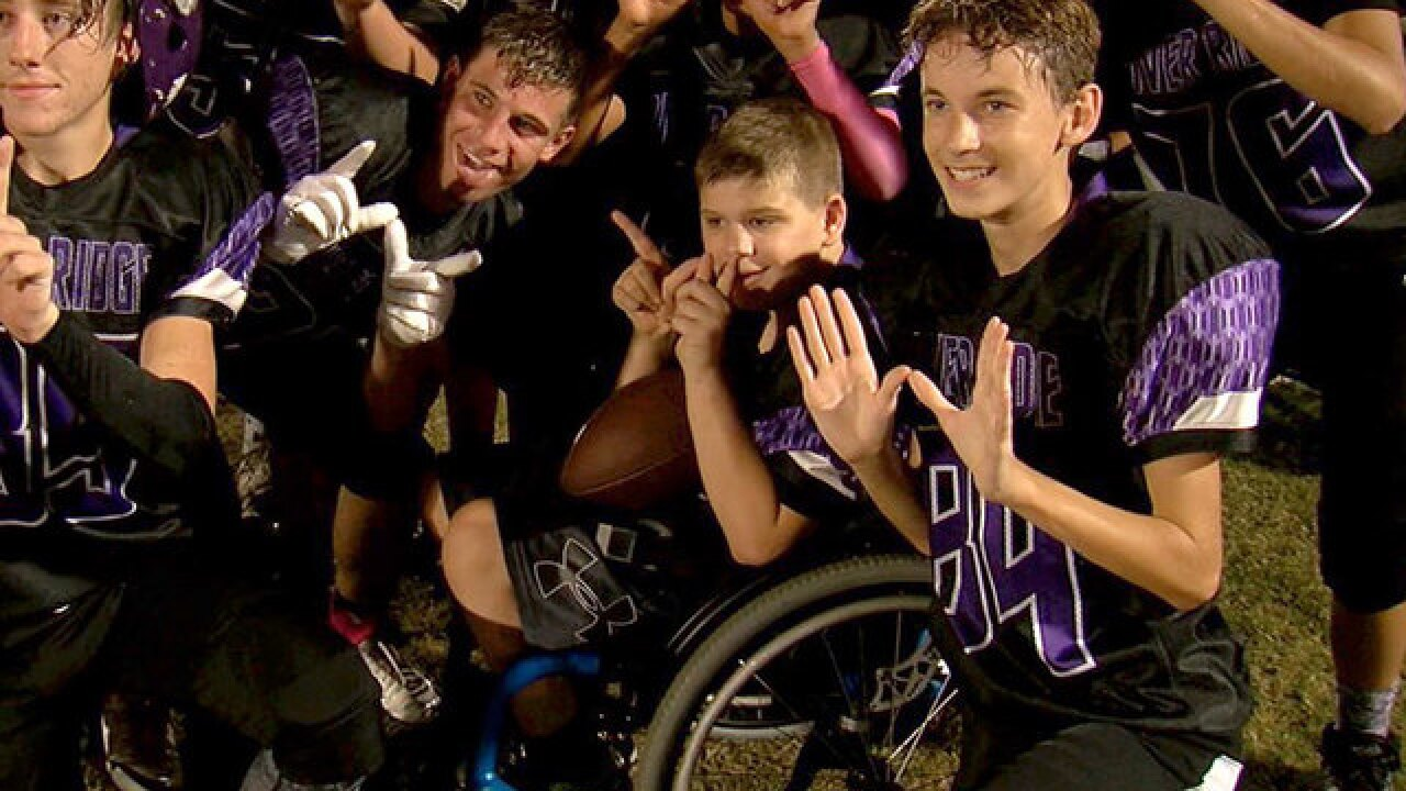 Middle school football team helps fellow student