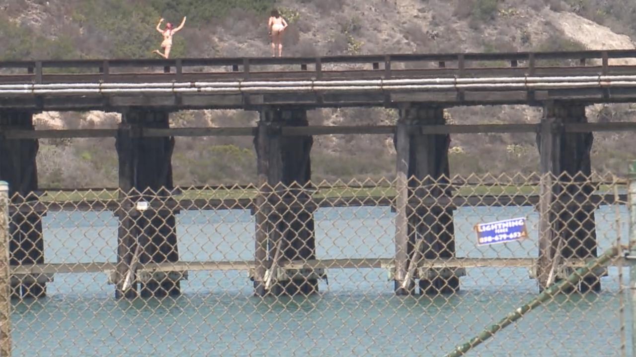 Teens jump into Batiquitos Lagoon