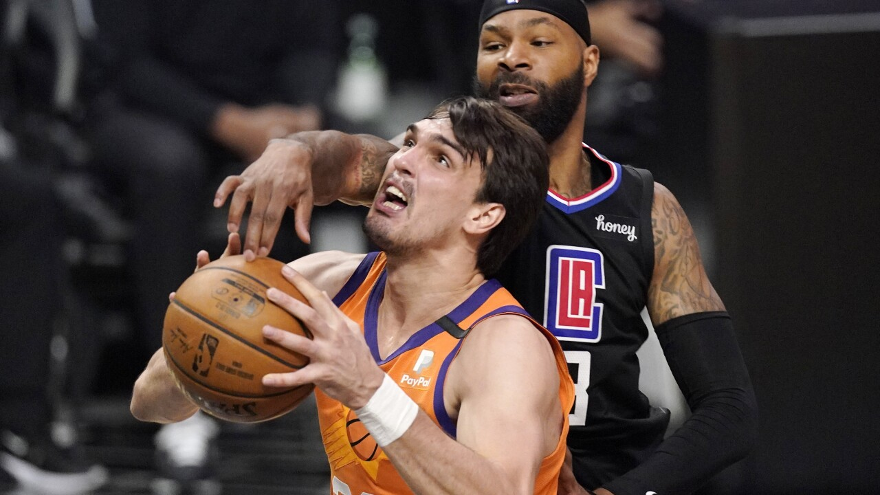 Phoenix Suns forward Dario Saric has a torn ACL in his right knee that he suffered during the first quarter of Game 1 of the NBA Finals on Tuesday night. AP photo.