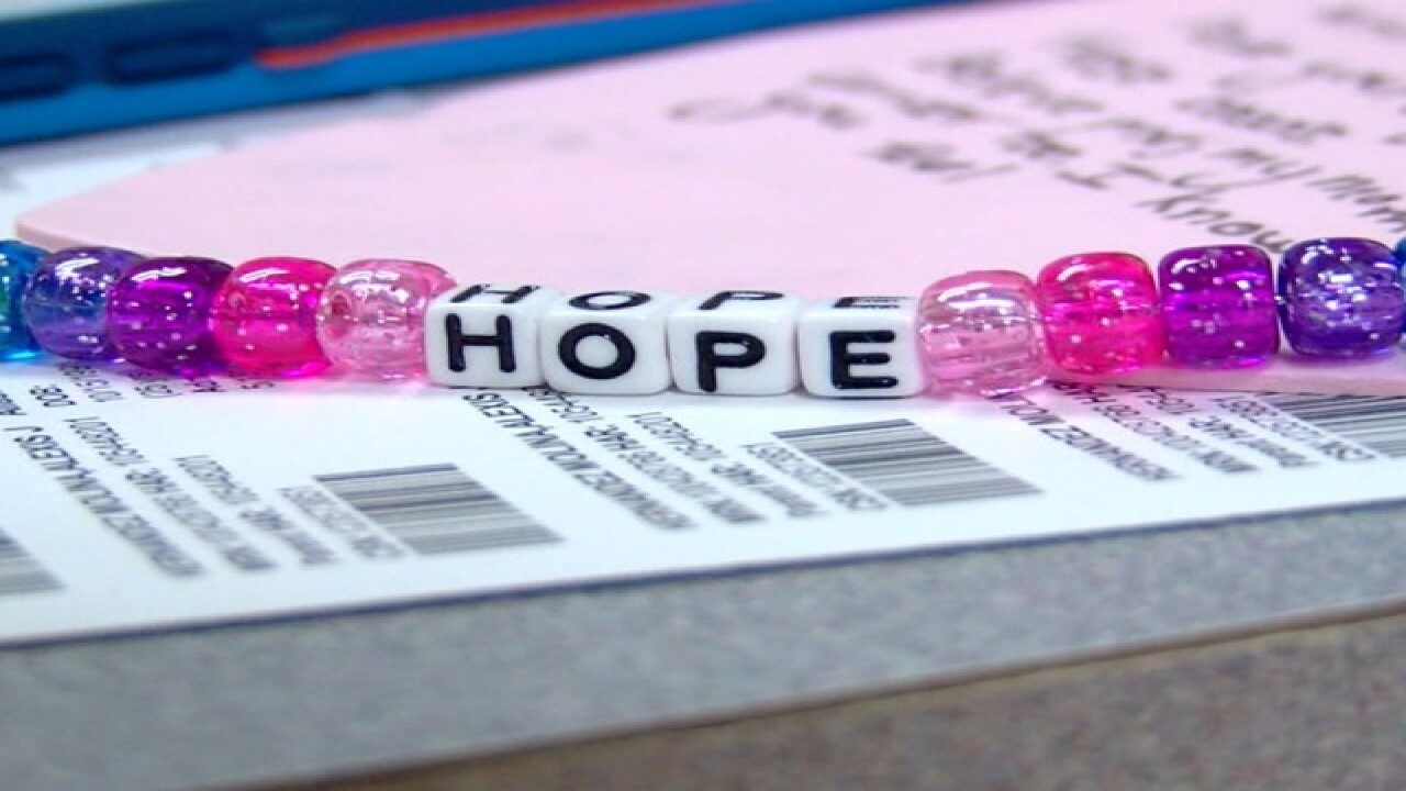 8 YO hands cancer patients hope beads