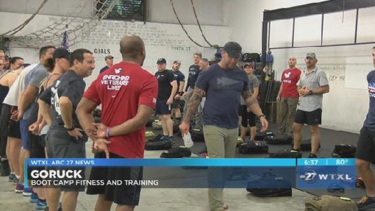 Community takes part in workout in front of military members