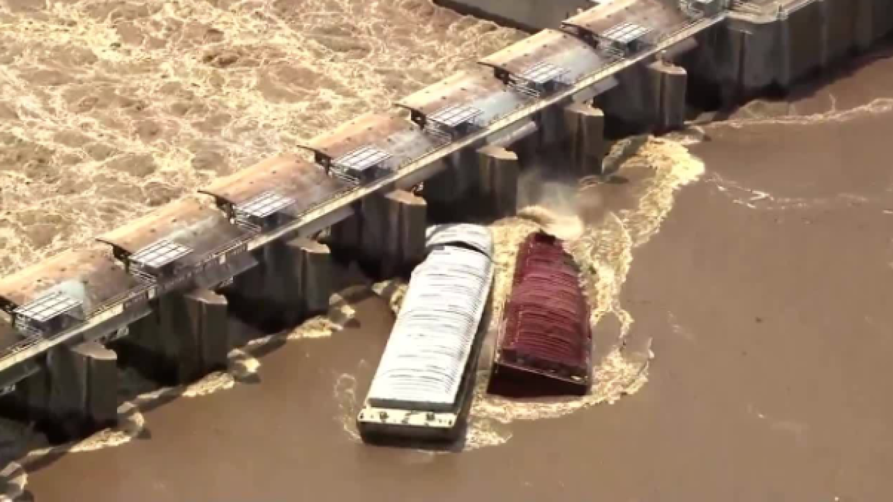 Barges crash into dam during flooding in Oklahoma