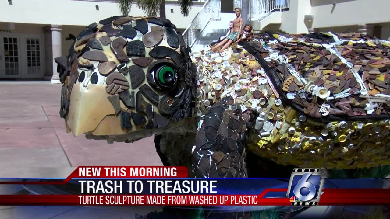 Washed up plastics create an educational message on how this can affect marine life.