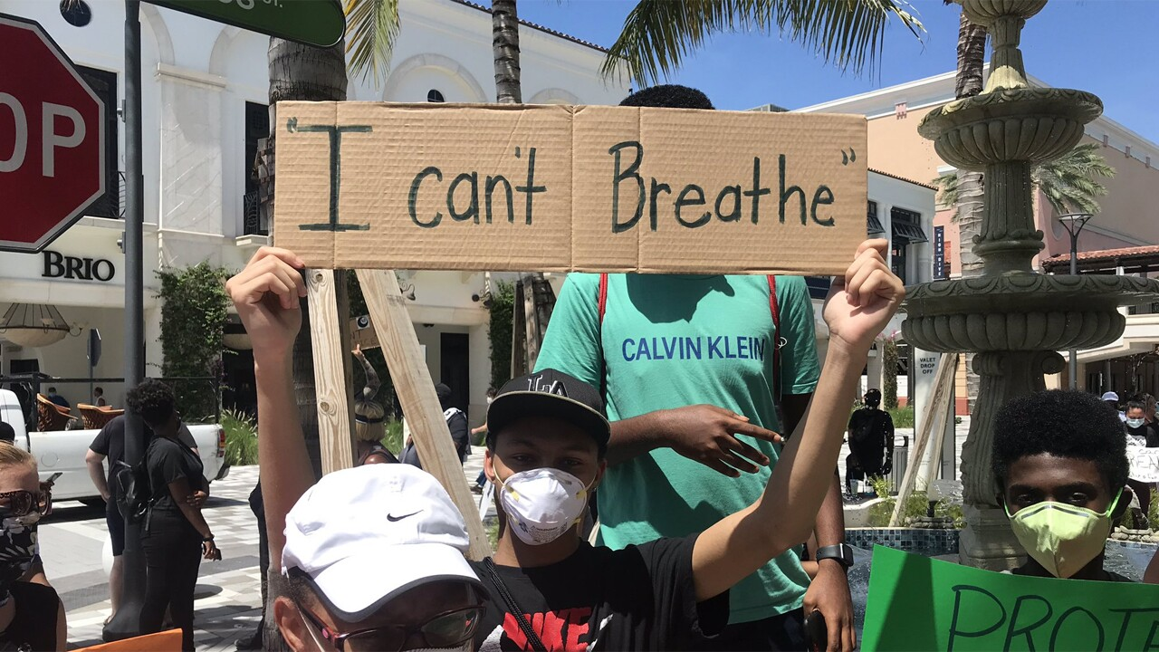 Protesters march in downtown West Palm Beach on May 31, 2020 after the death of George Floyd.