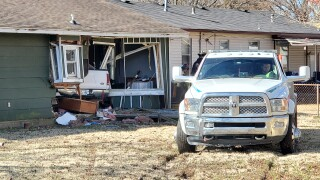 Truck crashes into West Tulsa house
