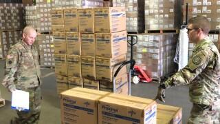 National Guard helping load medical supplies