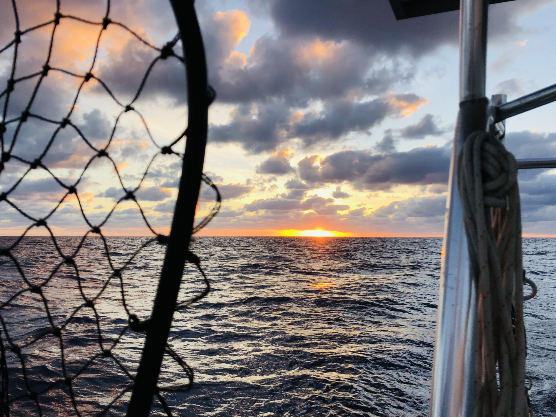 sun rises on horizon view from Marty Widrick and Sven Karrlson's sailboat