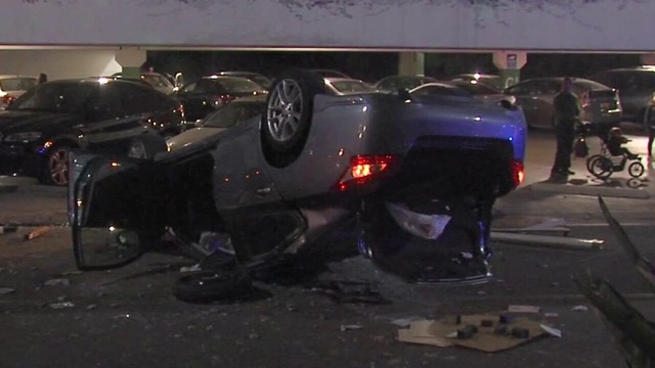 Car nosedives off mall parking garage