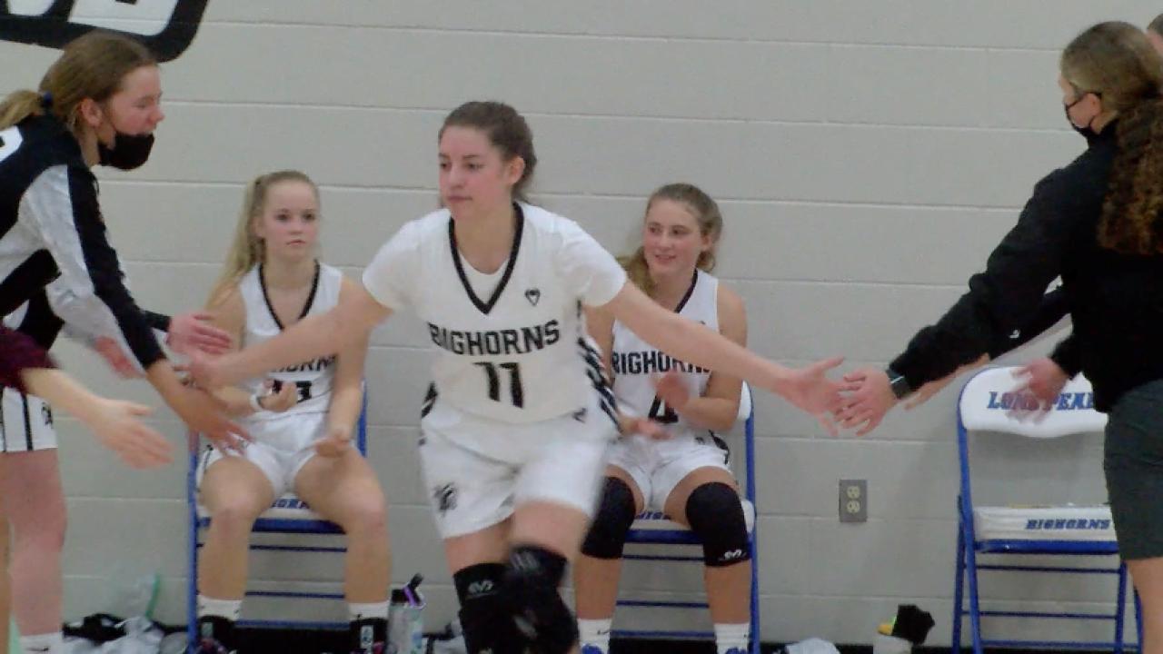 Lone Peak's Ivy Hicks dabs up her teammates