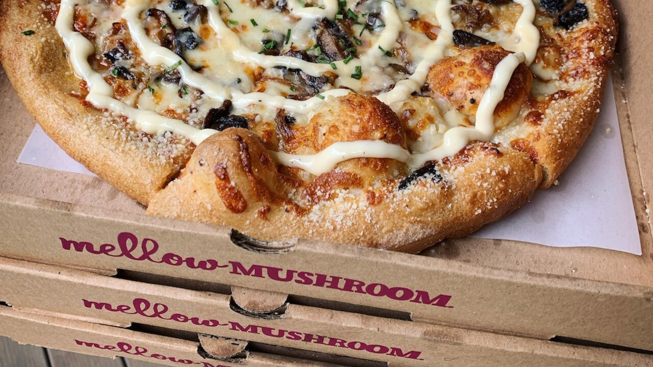Mellow Mushroom pizza on top of boxes