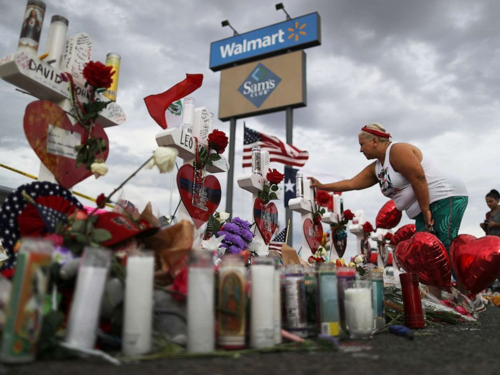 A woman touches a cross at a makeshift memorial for victims outside Walmart, near the scene of a mass shooting which left at least 22 people dead, on Aug. 6, 2019 in El Paso, Texas (Mario Tama/Getty Images).