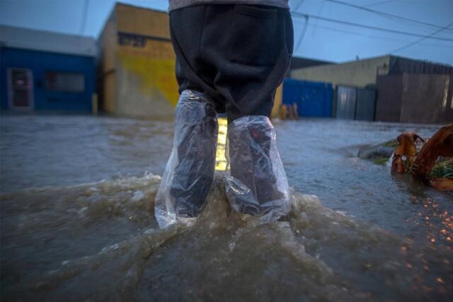 Floods swallow California as severe storms kill three