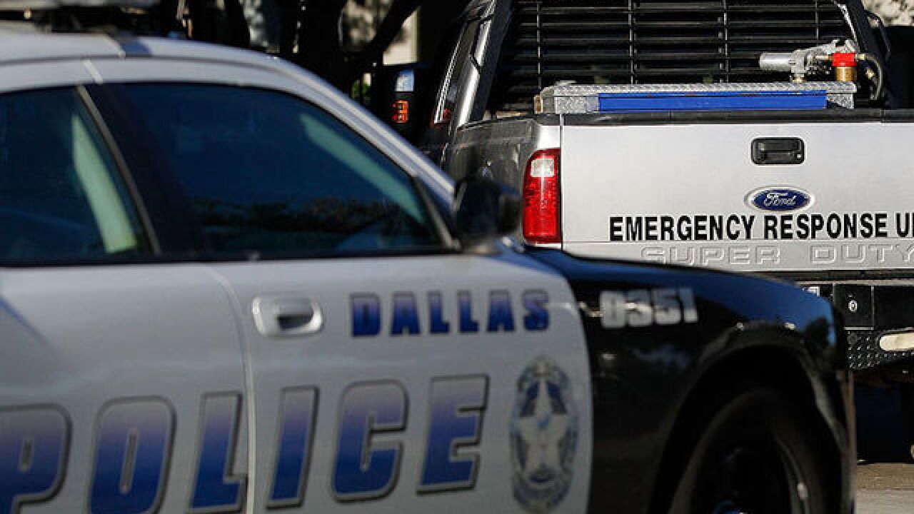 Manhunt over after 2 Dallas officers and Home Depot employee shot