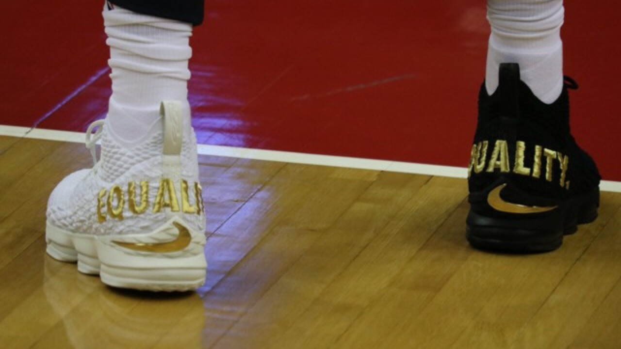 c2c9a933897 LeBron wears  equality  shoes — one black and one white