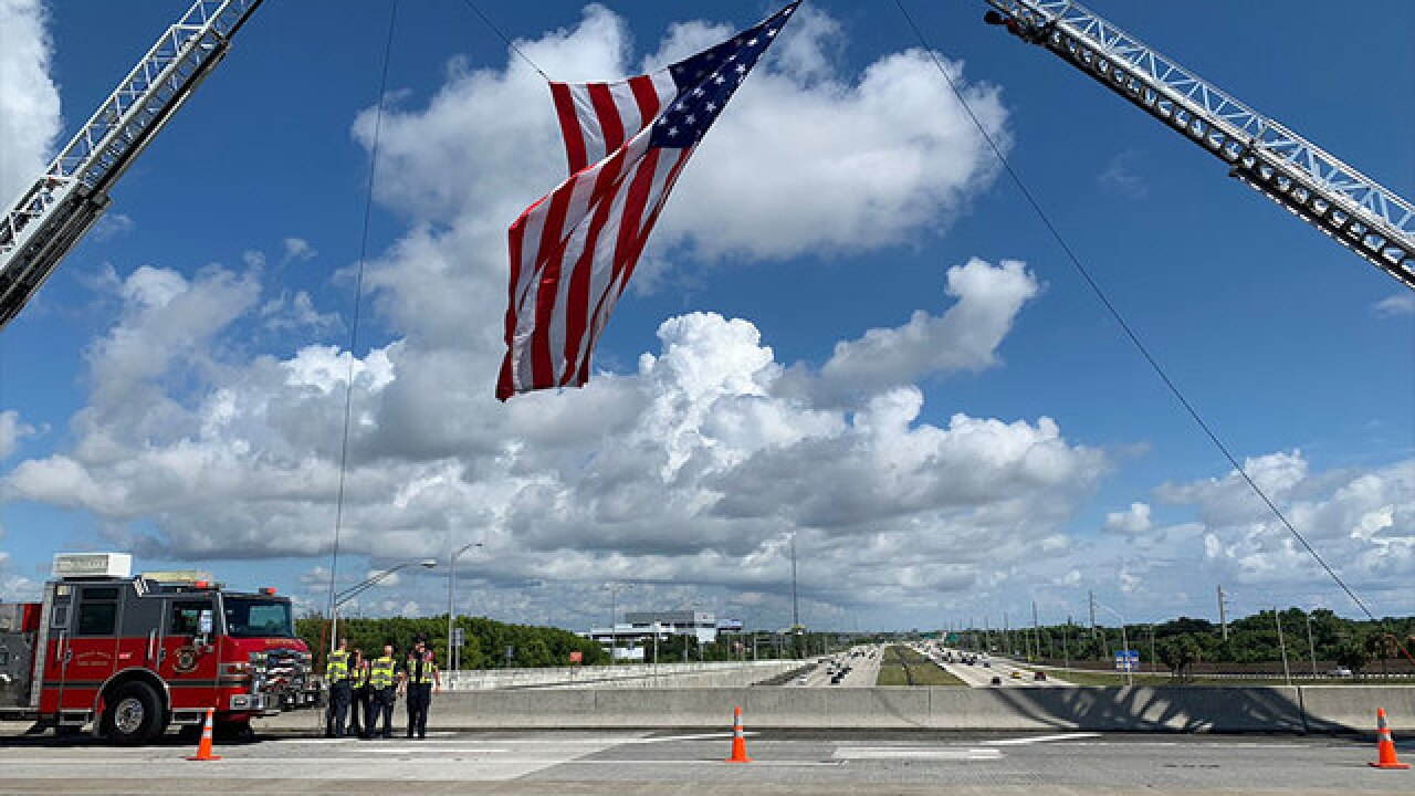 American flags above I-95 welcome home firefighters who were working in the Carolinas