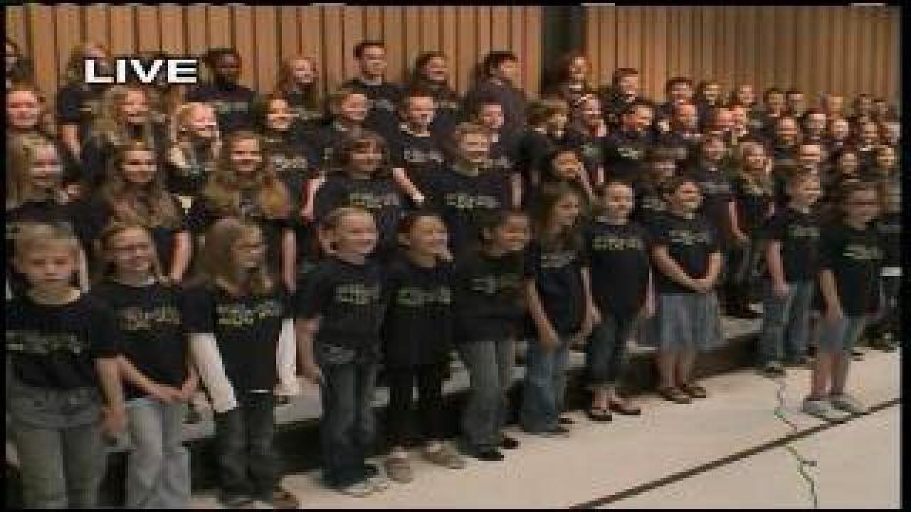 Elementary students sing school song