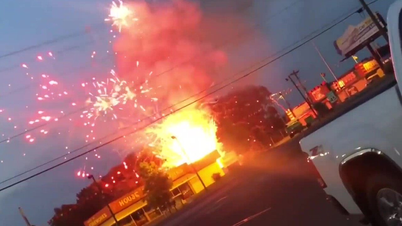 Firefighters had to dodge exploding rockets to douse a spectacular fire that destroyed containers of fireworks stored for sale on the Fourth of July.