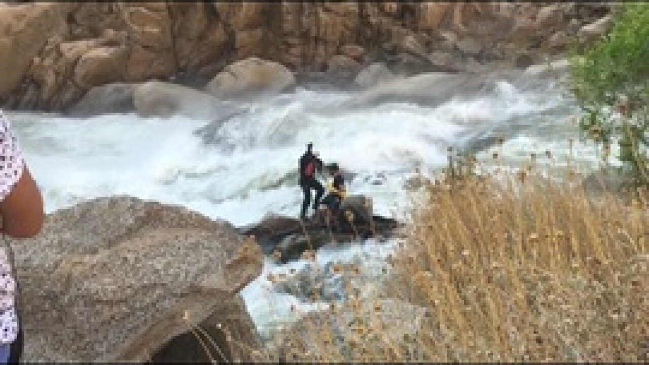VIDEO: Harrowing rescue from raging river