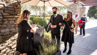 Guests arrive in masks for small private tastings at Tolosa Winery.
