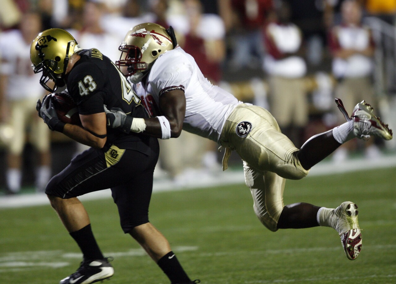 Florida State Seminoles linebacker Geno Hayes tackles Colorado Buffaloes fullback Samson Jagoras in 2007