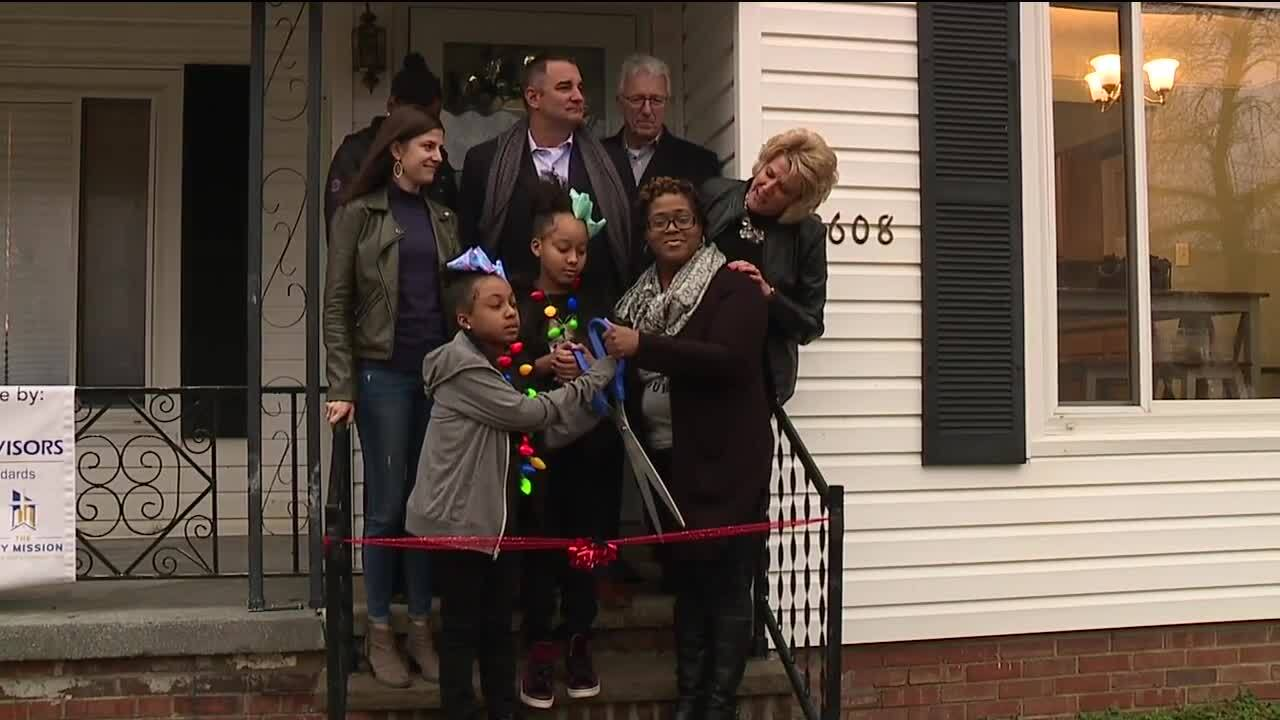 Community buys house for mom