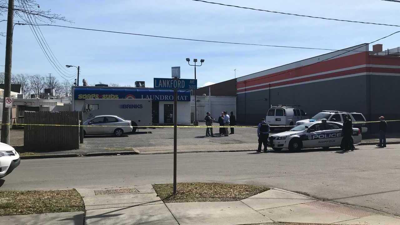 Man in motorcycle helmet robs armored vehicle at gunpoint inNorfolk