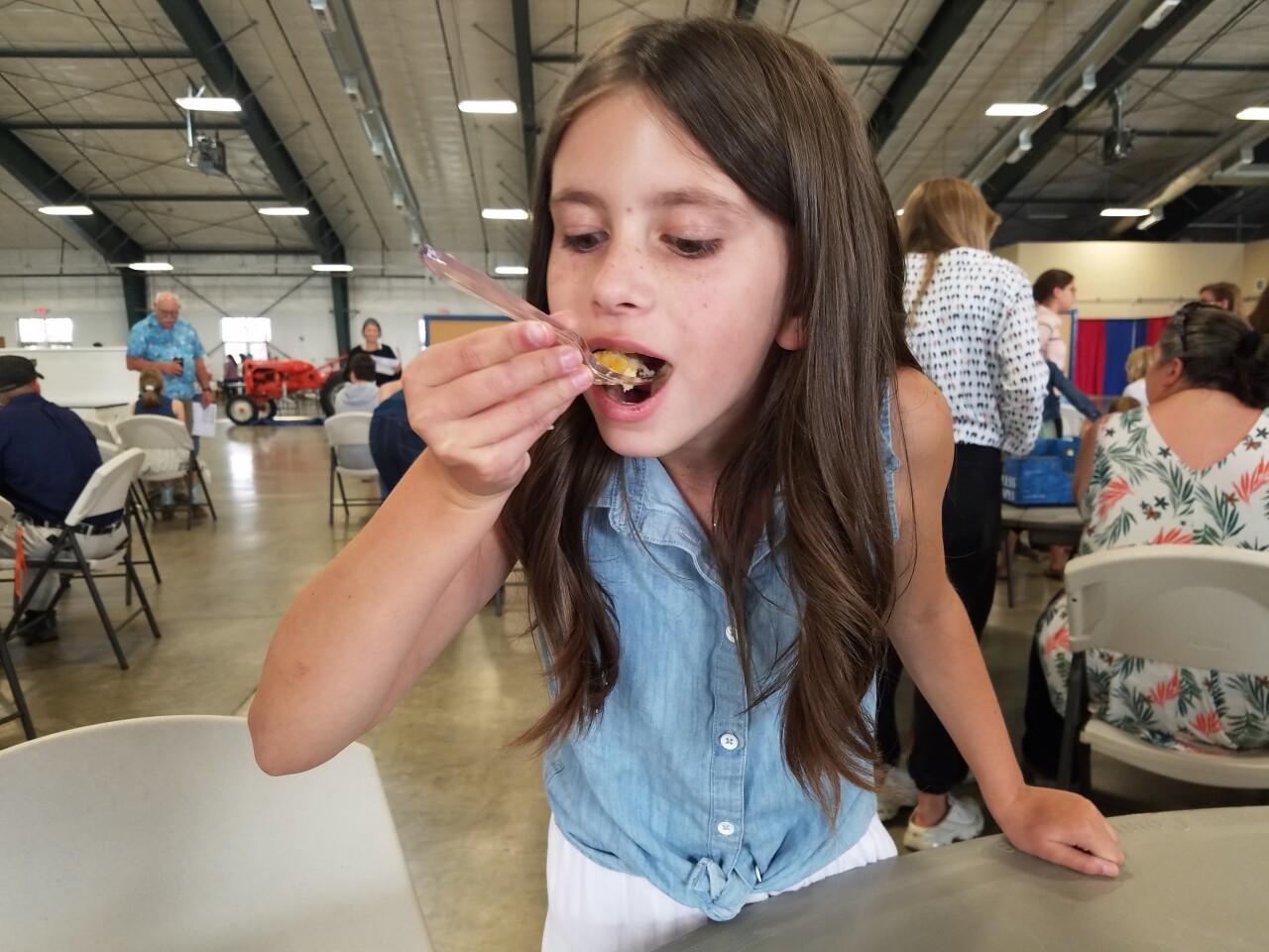 Kaylin Manning enjoying a fellow 4-H member's baking project