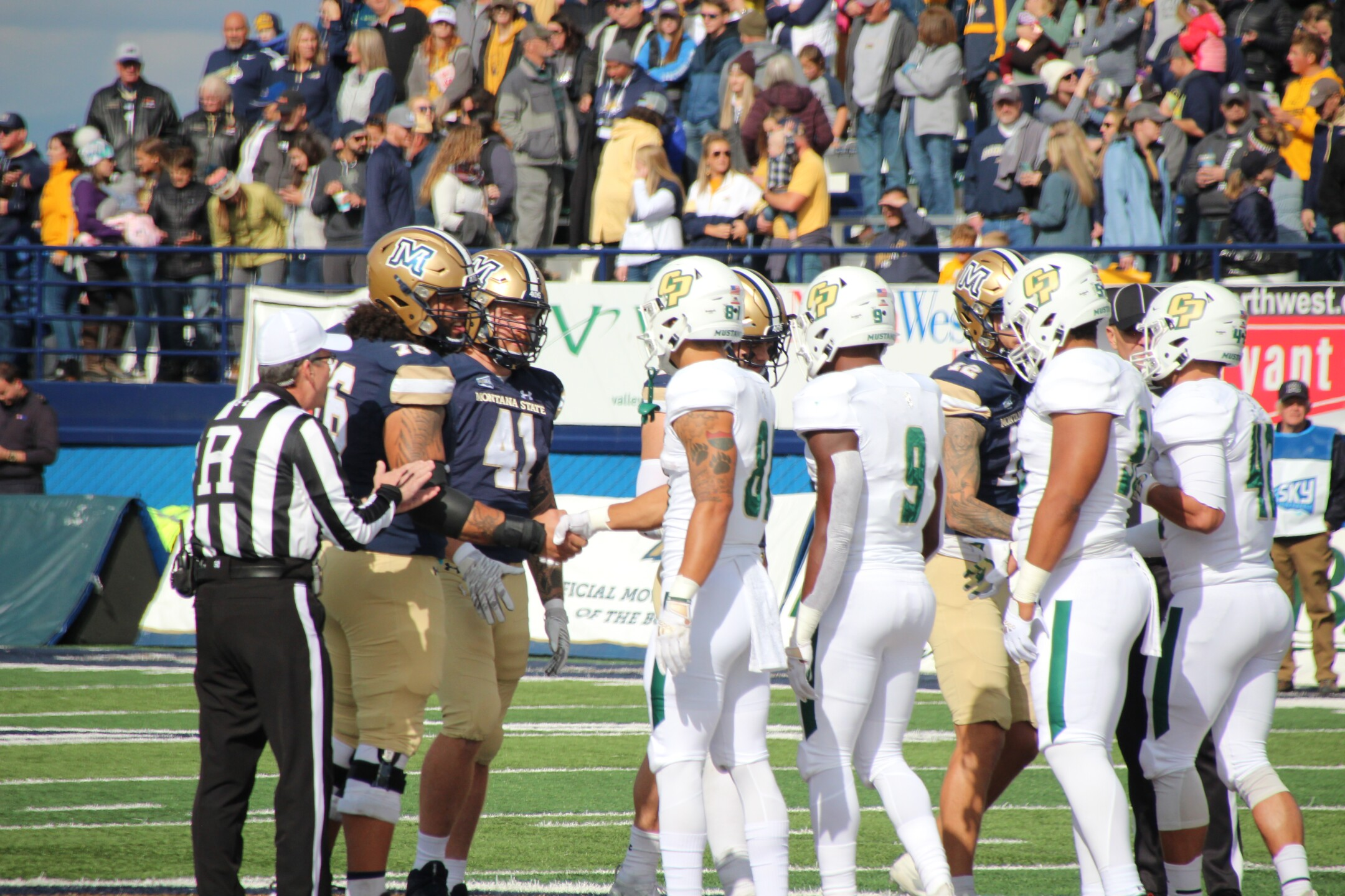 MSU Captains shake hands with Cal Poly before the game