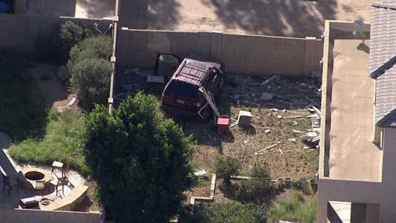 FD: Car crashes into Phoenix home, no one hurt