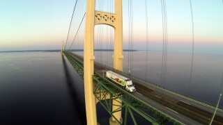 Spartan Nash truck driver retirement send-off with photos on Mackinac Bridge