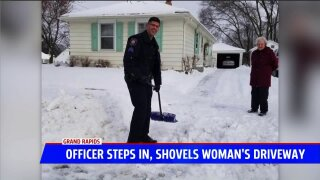 Grand Rapids officer 'caught' shoveling elderly resident's snow