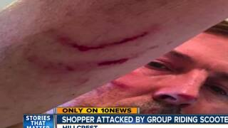 Man beaten by group riding scooters