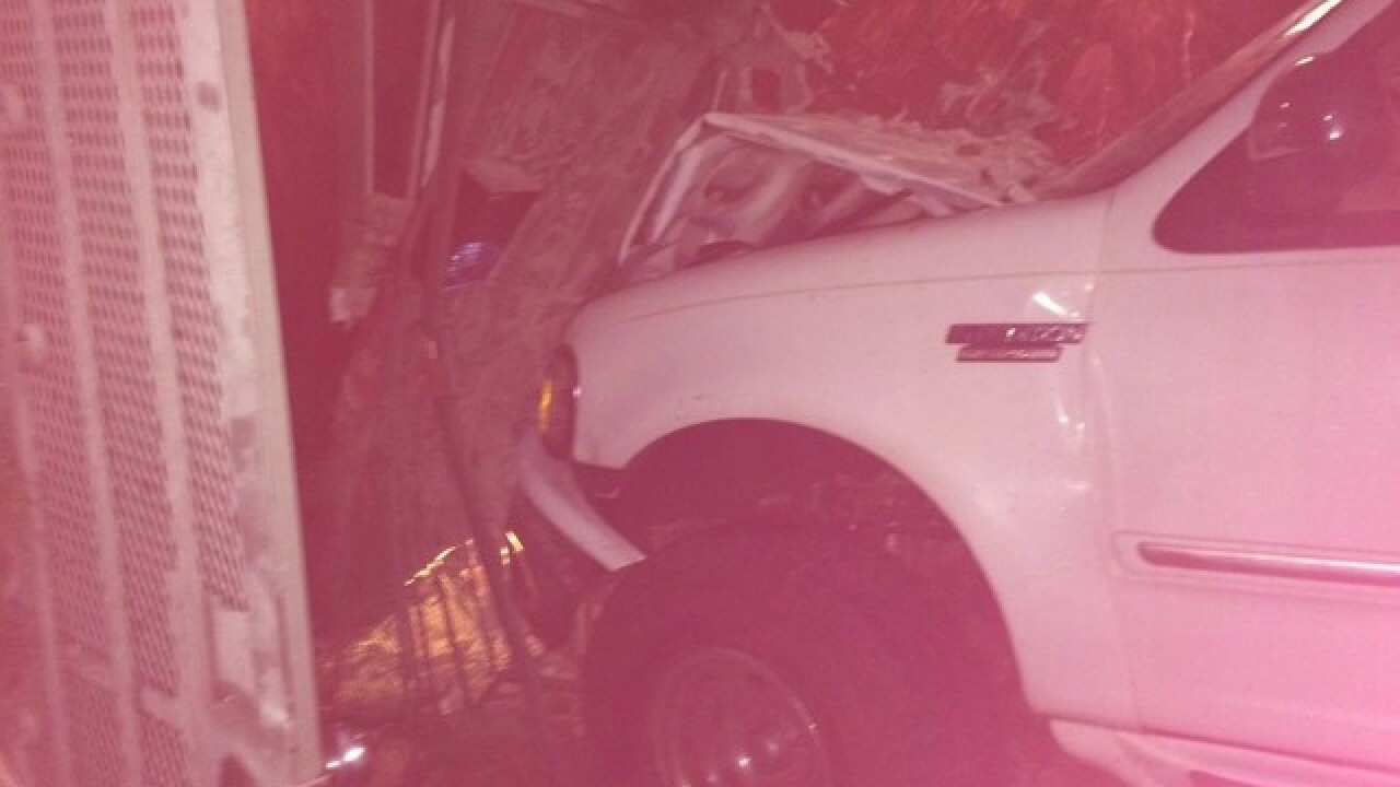 Suspected drunk driver slams into car, building