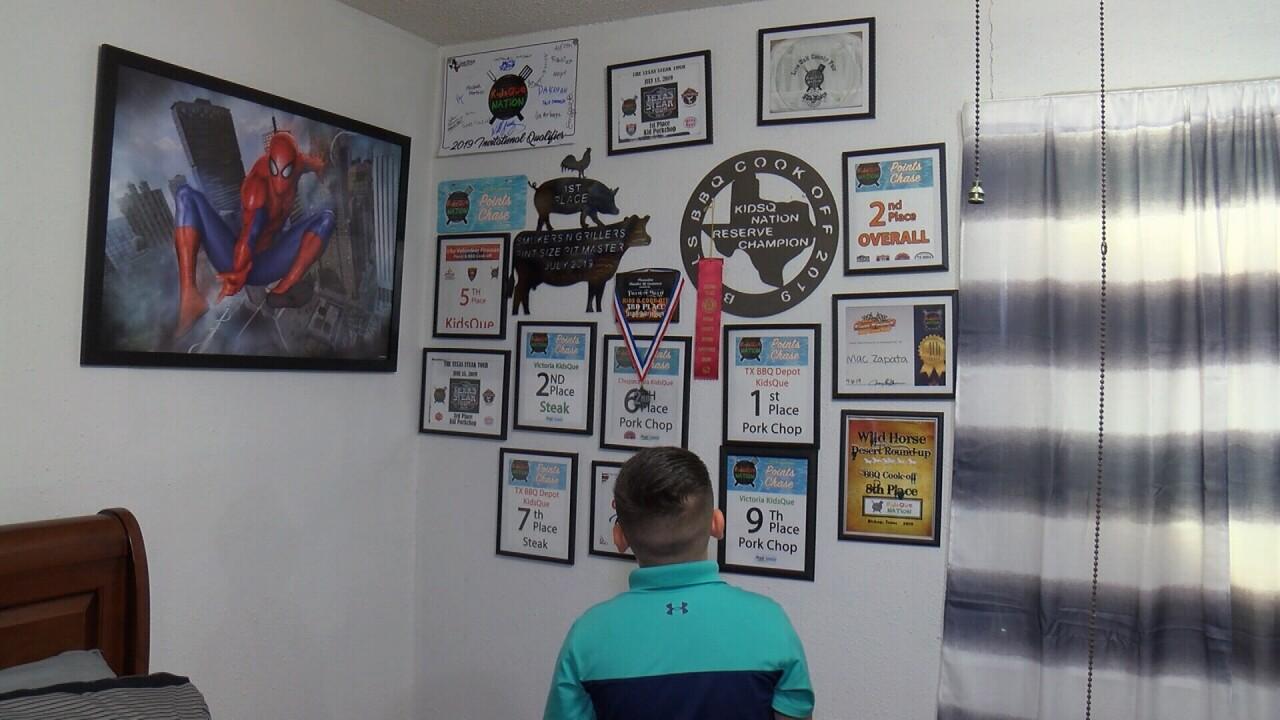 MAC ZAPATA WITH AWARDS.jpg