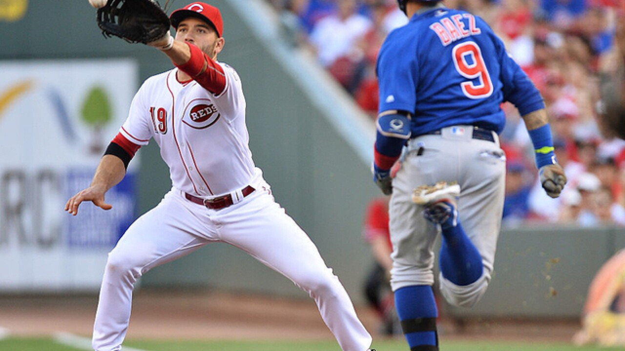 Cubs play 3 relievers in LF while beating Reds in 15-inning game
