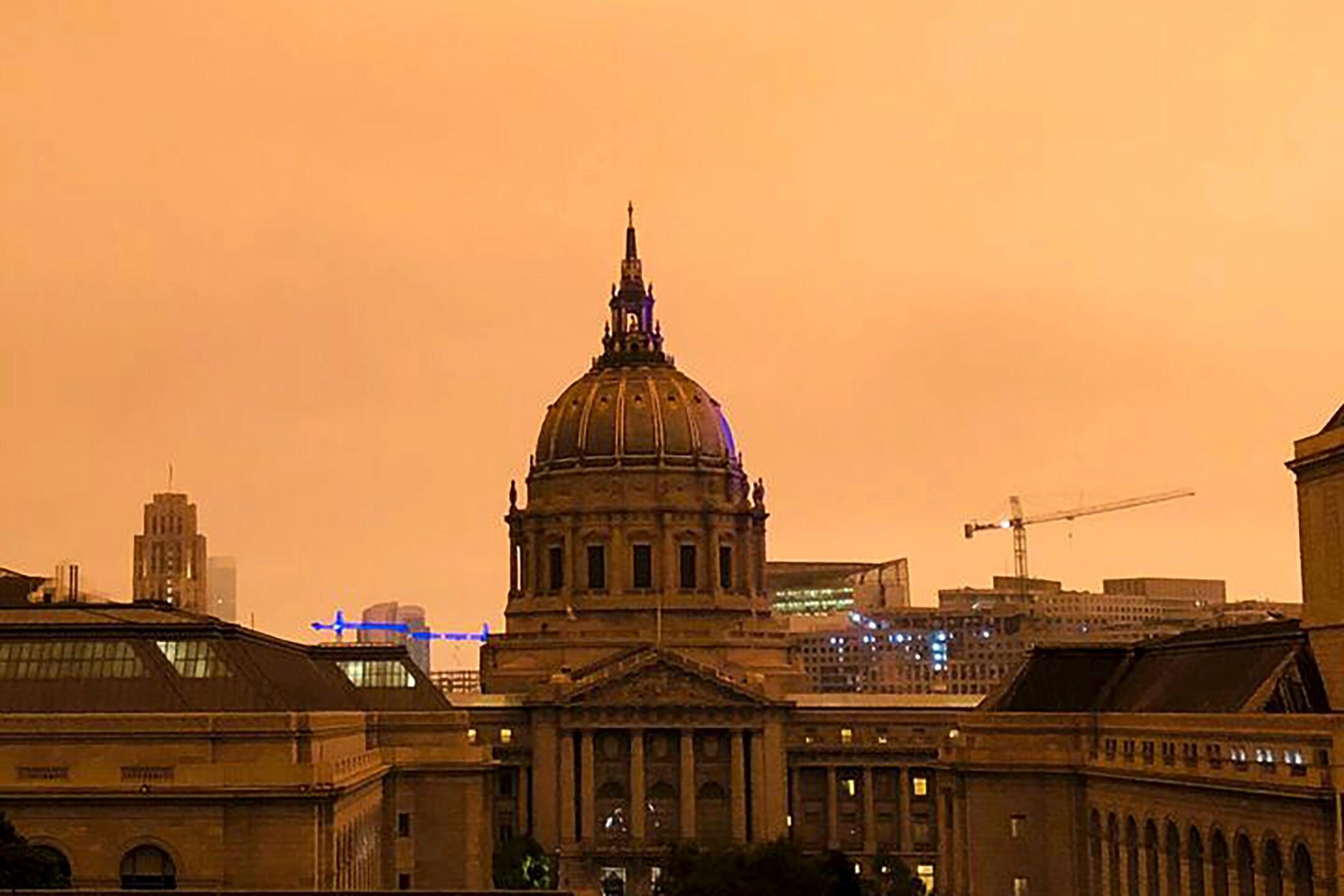 Smoke from California wildfires turned the San Francisco sky bright orange on Wednesday night