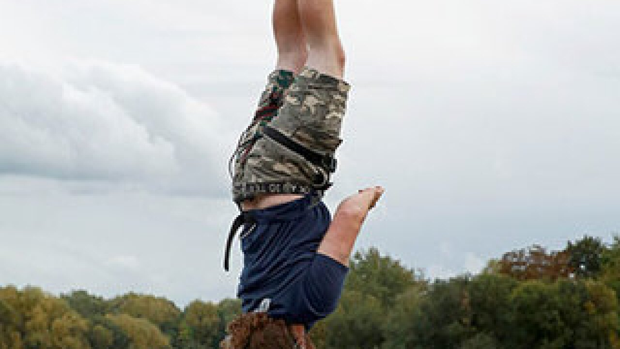 Man completes highest ever bungee dunk
