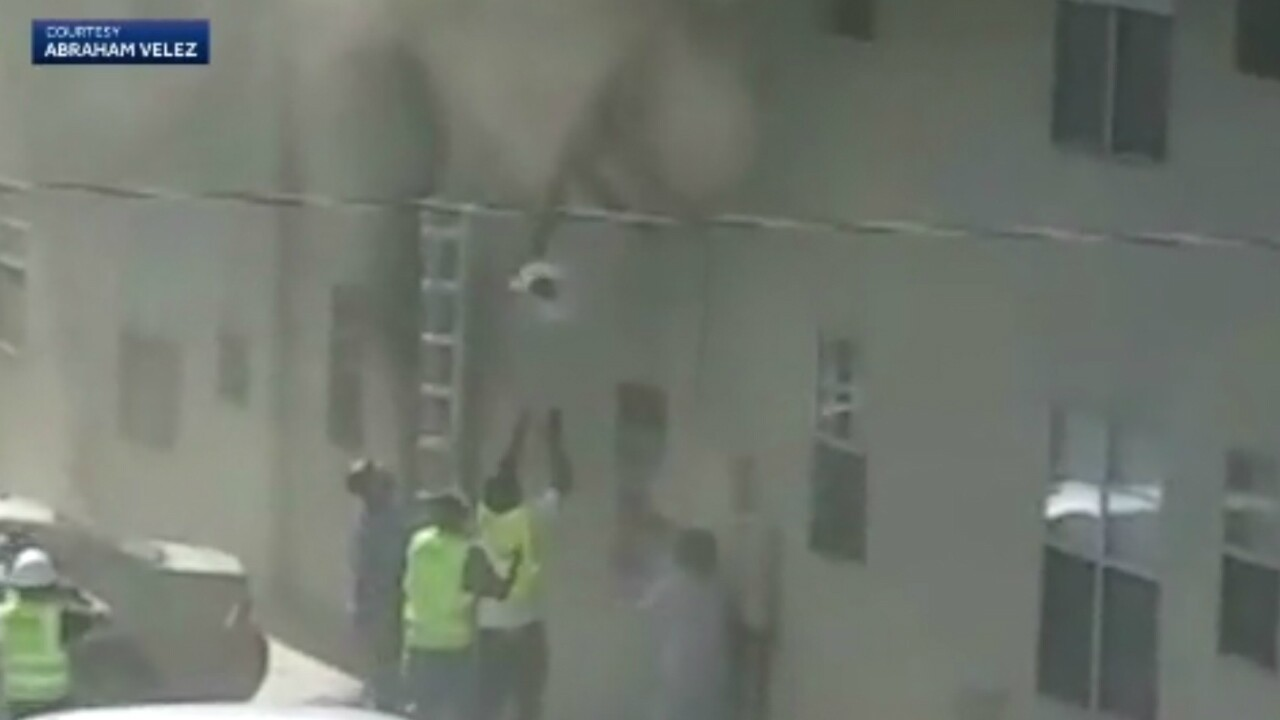 A New Mexico man rescues baby and toddle from burning building