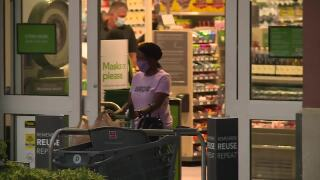 Shoppers wearing masks at downtown West Palm Beach Publix, May 15, 2021