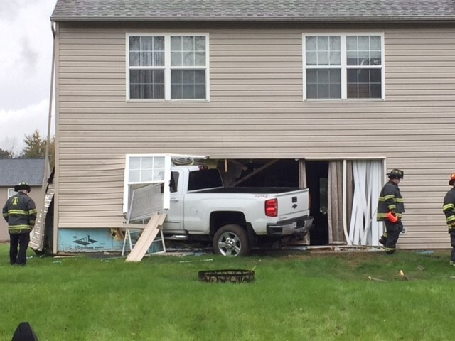 PHOTOS: Truck crashes into home on Indianapolis' southwest side
