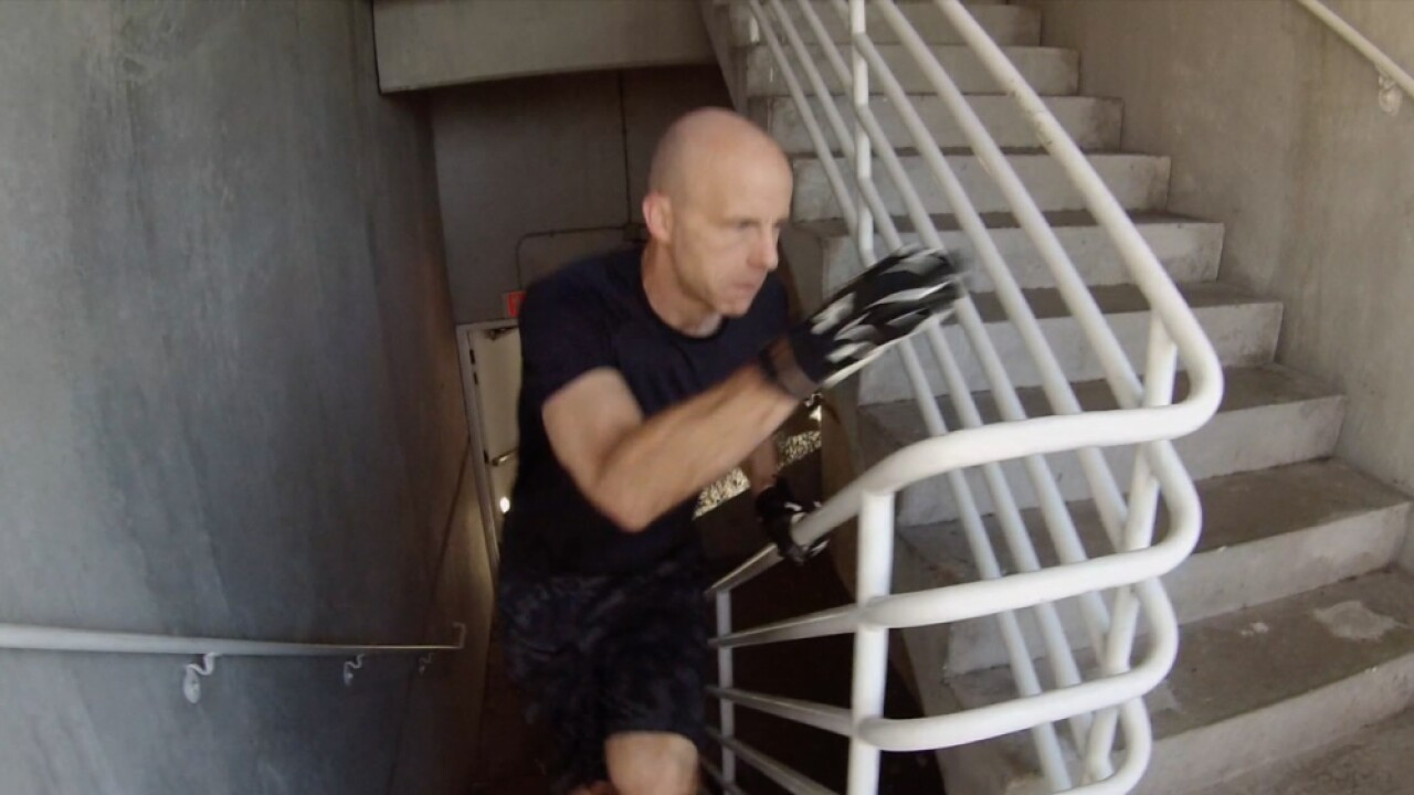 Chris Van Glahn running up stairs