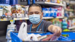 Walmart personal shopper wearing mask