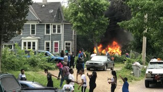 Van on fire next to home at 40th and Lloyd that is eventually burned down.