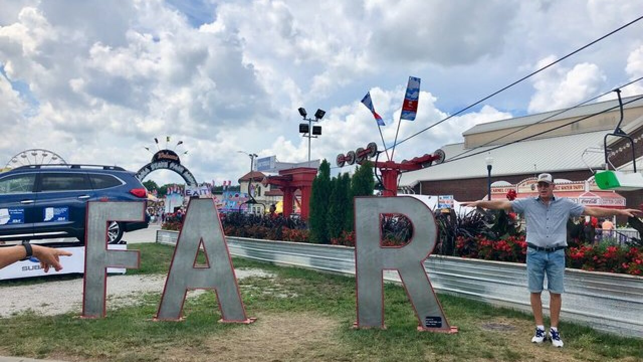Dad at Indiana State Fair does the most dad thing ever, spells 'FART'