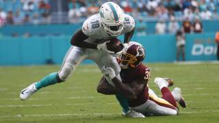 Washington Redskins wide receiver Trey Quinn (18) tackles Miami Dolphins wide receiver Preston Williams (18), during the second half at an NFL football game, Sunday, Oct. 13, 2019, in Miami Gardens, Fla.